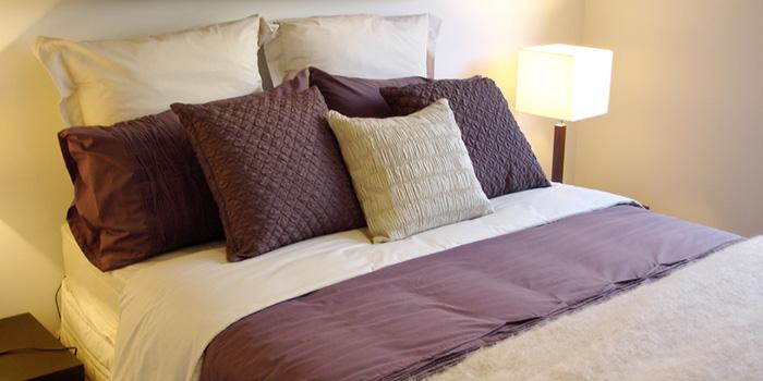 Modern bedroom with warm purple tones
